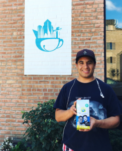 Rene holding a bag of Aspire CoffeeWorks coffee.